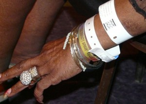 Carol Fran's hand showing rings and bracelets.